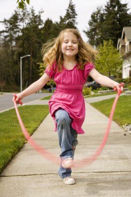 Cute little girl skipping rope