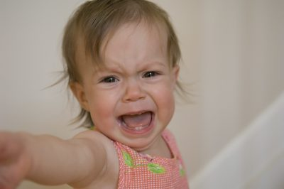 Baby girl crying and throwing a temper tantrum