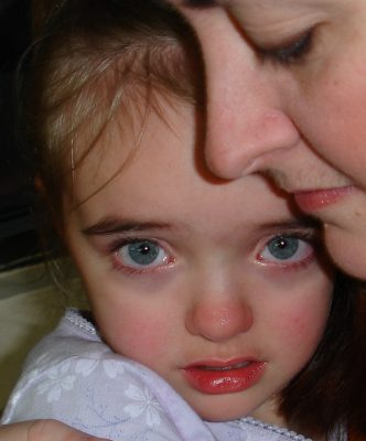 Mother comforting sad child